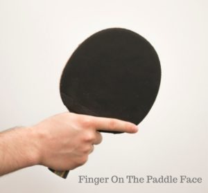 Finger on the paddle face